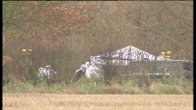 Police narrow list of suspects / Tania Nicol's parents' press conference TX Near Levington Forensic team wearing white protective clothing next white...