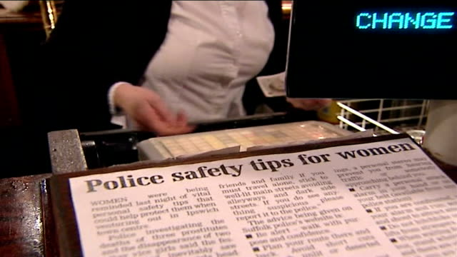 police narrow list of suspects / tania nicol's parents' press conference 'police safety tips' newspaper article stuck to till in bar - narrow stock videos & royalty-free footage