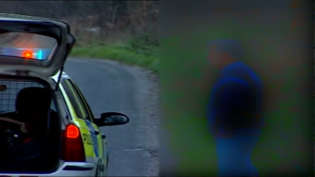 two more bodies found making five in total; england: suffolk: ext / evening * * itv exclusive * * police officer away down road as turns and speaks... - bending over stock videos & royalty-free footage