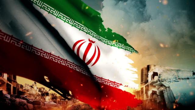 4k iran flag - crisis / war / fire (loop) - iran stock videos and b-roll footage