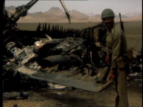 operation eagle claw aborted commander denies wanting to go ahead a lib iran tabas desert ext pan helicopter wreckage to soldier lifting rotor blade... - claw stock videos & royalty-free footage
