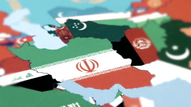 iran with national flag on world map - china east asia stock videos & royalty-free footage