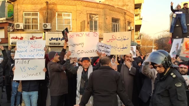 iranian demonstrators gather outside the british embassy calling for its closure during an antibritain protest on january 12 2020 in tehran iran - tehran stock videos & royalty-free footage