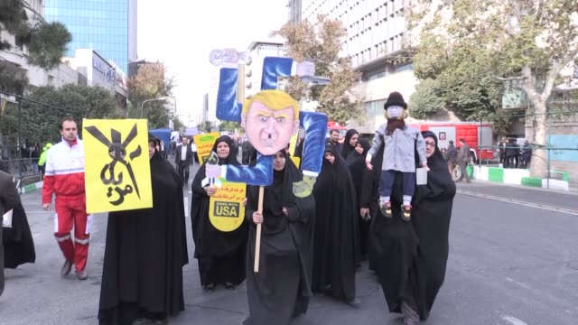 iranian demonstrators take part in an antius rally in front of the former us embassy in tehran on november 04 marking the 39th anniversary of the us... - iran stock videos & royalty-free footage