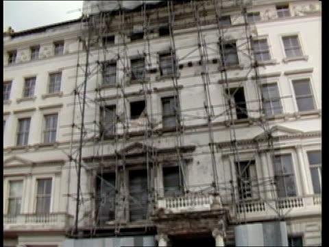 iranian embassy siege: compensation agreed; england: london: princes gate: iranian embassy: ext av iran embassy building under scaffolding tilt down... - door chain stock videos & royalty-free footage
