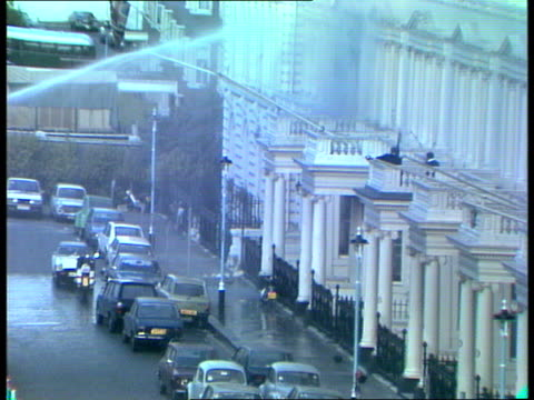 itn live feed 1930 2030 2000 england london kensington princes gate iranian embassy iranian embassy in immediate aftermath of siege / gvs fire... - helicopter stock videos & royalty-free footage