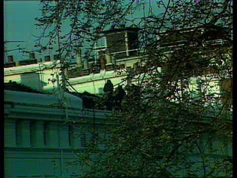 itn live feed 1930 2030 england london kensington princes gate iranian embassy iranian embassy as siege in progress / long shot sas troops on roof... - free falling stock videos & royalty-free footage