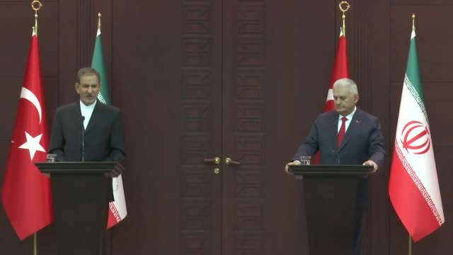 iranian first vice president eshaq jahangiri speaks at a joint press conference with turkish prime minister binali yildirim following their meeting... - トルコ首相点の映像素材/bロール