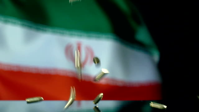 iranian flag behind bullets falling in slow motion - army stock videos & royalty-free footage