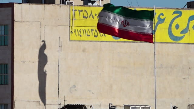 iranian flag blowing in the wind - iran stock videos & royalty-free footage