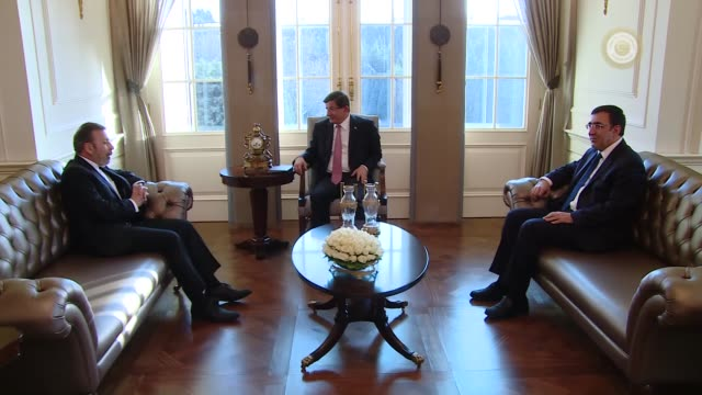 iranian information and communications technology minister mahmoud vaezi meets with turkish prime minister ahmet davutoglu at the cankaya palace in... - primo ministro turco video stock e b–roll