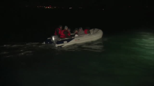 iranian migrants crossing english channel to uk in small dinghy - english channel stock videos & royalty-free footage