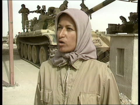 iranian mujahaddin dissident army; cms zahara ostadhassan guiding tank along cms zahara ostadhassan intvwd sof - killed many iranian revolutionary... - marching stock videos & royalty-free footage