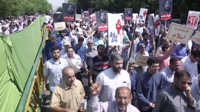 vídeos de stock, filmes e b-roll de iranian muslims hold banners and shout slogans during a protest following the friday prayer in tehran on september 8 condemning the myanmar army's... - 2017
