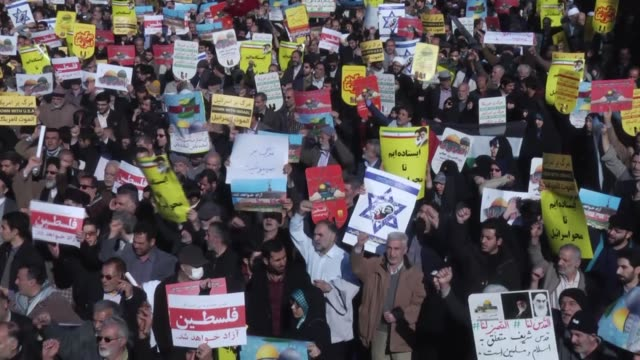 vídeos de stock, filmes e b-roll de iranian muslims stage a protest in tehran against the us president donald trump's announcement to recognize jerusalem as the capital of israel and... - 2017