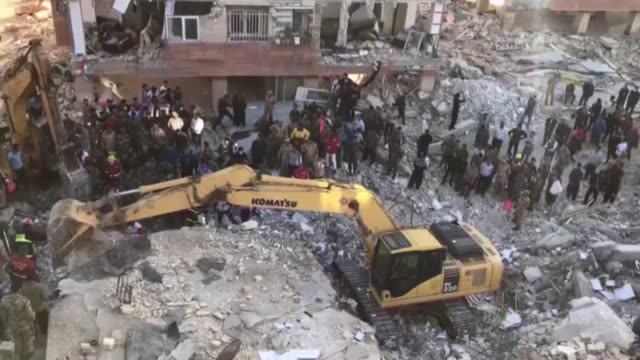 iranian officials search for survivors in the rubble of buildings a day after a powerful 73 earthquake struck the city of kermanshah iran on november... - destruction stock videos & royalty-free footage
