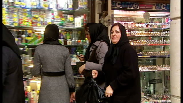 iranian president denies supplying sophisticated weapons to iraqi militants; iran: tehran: ext general view of iranian men along in bazaar shoppers... - general view stock videos & royalty-free footage
