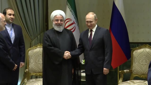 Iranian President Hassan Rouhani and his Russian counterpart Vladimir Putin hold a meeting at presidential complex in Ankara Turkey on April 04 2018