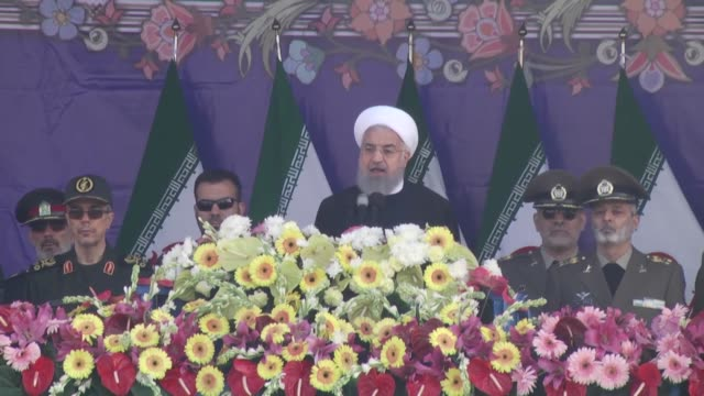 iranian president hassan rouhani and senior members of iranian armed forces watch a parade on the occasion of the country's annual army day on april... - military parade stock videos & royalty-free footage