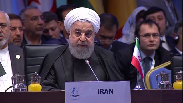 Iranian President Hassan Rouhani delivers a speech at the extraordinary summit of the Organization of Islamic Cooperation in Istanbul Turkey on...