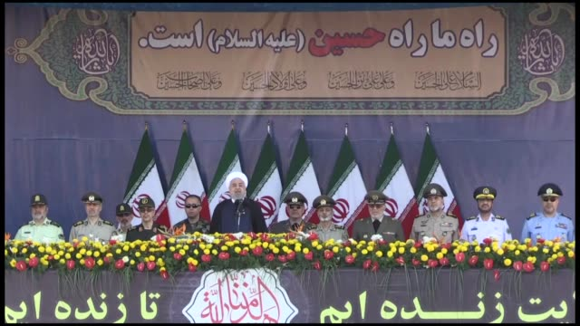 iranian president hassan rouhani delivers a speech during the annual military parade marking the anniversary of the outbreak of the devastating... - iran stock videos & royalty-free footage