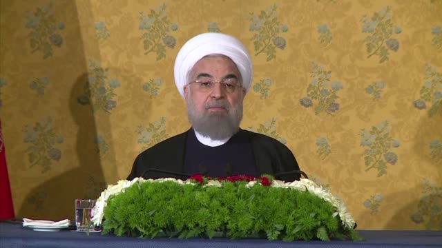 vídeos de stock e filmes b-roll de iranian president hassan rouhani insists free speech does not give people the right to violate the sancitity of other religions ahead of a trip to... - sátira
