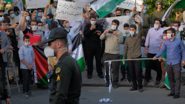 iranian protesters burn an israeli flag and the u.s. flag as the other protesters shout anti-u.s. and religious slogans during a protest gathering in... - other stock videos & royalty-free footage