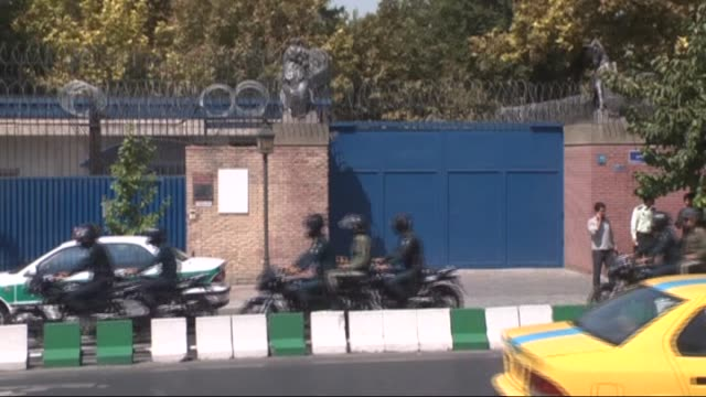 iranian security forces stand guard outside the british embassy during britain's foreign secretary philip hammond's visit to reopen it on august 23... - teheran stock videos & royalty-free footage