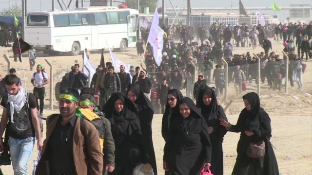 iranian shiite pilgrims are heading to karbala in iraq through the zurbatia land border crossing to mark the end of a 40 day mourning period for imam... - imam hussein stock videos and b-roll footage