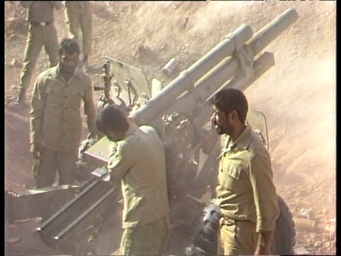 iranian soldiers load and fire missiles iran iraq war; 1984 - イラク点の映像素材/bロール