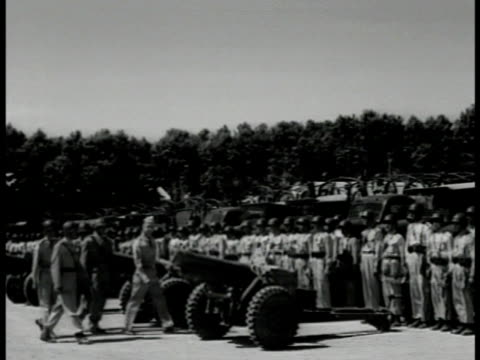 iranian soldiers troops standing at attention behind artillery lined up for for inspection american us officer inspecting weapon talking w/ iranian... - 1951 stock videos & royalty-free footage