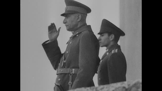 iranian troops soldiers marching ls reza shah pahlavi standing on balcony saluting ms reza shah pahlavi standing on balcony w/ son mohammed reza... - iran stock-videos und b-roll-filmmaterial