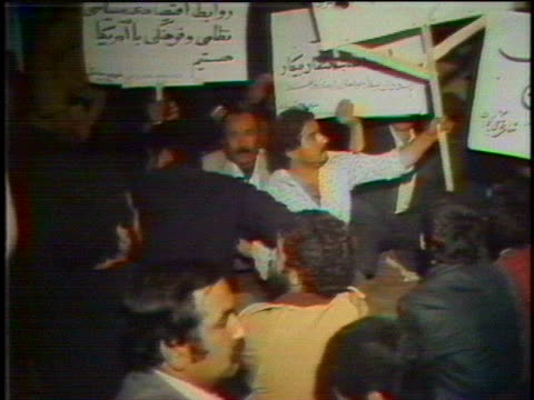 stockvideo's en b-roll-footage met iranian union workers stage a sitin at the iranian ministry of labor in 1979 protesting america's cutoff of imports of iranian oil - united states and (politics or government)
