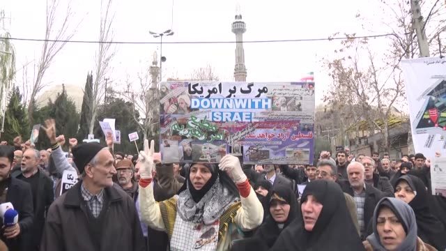 iranians hold banners and chant slogans against saudi arabia during the protest against execution of prominent shiite cleric nimr al-nimr by saudi... - execution stock videos & royalty-free footage