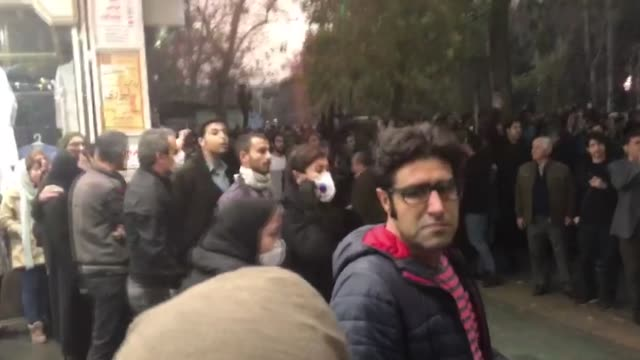 vídeos de stock, filmes e b-roll de iranians protest during a demonstration driven by anger over economic problems in the capital tehran on december 30 2017 - irã