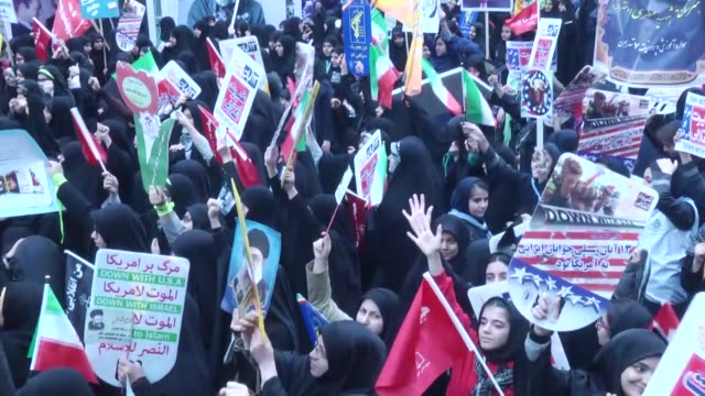 iranians take part during an antius demonstration marking the 38th anniversary of us embassy takeover in front of the former us embassy in tehran... - national security agency usa stock videos and b-roll footage