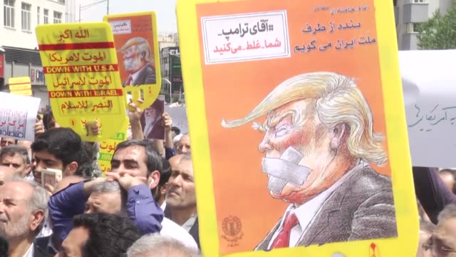 iranians take part in an antius demonstration after friday prayer to protest us president donald trump's decision to withdraw the us from the iran... - tehran stock videos & royalty-free footage