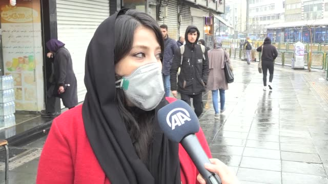 iranians wear masks after two died from the coronavirus in qom province, on february 20, 2020 in tehran, iran. on wednesday, china's national health... - news event stock videos & royalty-free footage