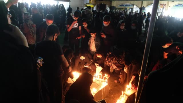 iranians wearing protective face masks light candles while attending a ceremony to commemorate ashura in northern tehran on august 30 amid the new... - ashura muharram stock videos & royalty-free footage