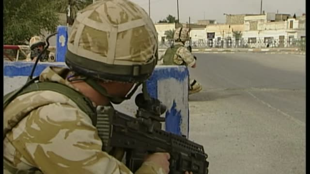 iraq abuse allegations david cameron condemns lawyers who hound veterans r20030622 / march 2006 iraq al amara british troops at road checkpoint - hound stock videos & royalty-free footage