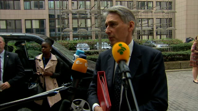 philip hammond interview; belgium: brussels: ext philip hammond mp along and interview sot - we're going to discuss the situation in ukraine, gaza... - request stock videos & royalty-free footage