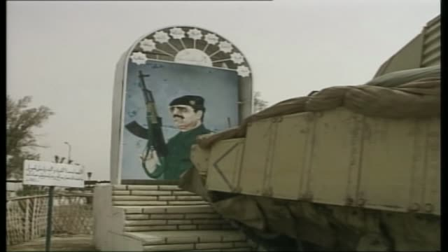 chilcot report to be published in june or july 2016; lib / 27.3.2003 iraq: basra: british army warrior armoured personnel carrier demolishing a mural... - saddam hussein stock videos & royalty-free footage