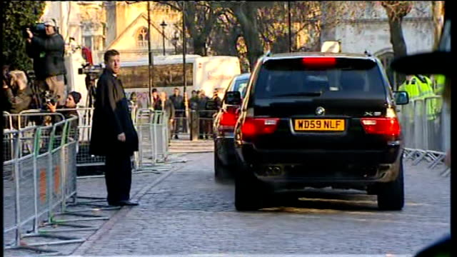 Tony Blair departure ENGLAND London Westminster EXT Police on duty outside conference centre Cars pull up outside venue Very quick long side shot of...