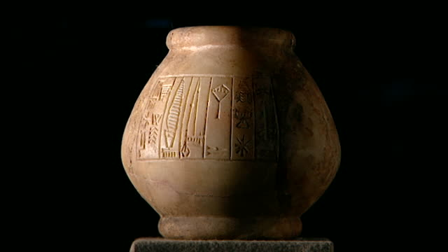iraq museum. view of an ancient mesopotamian stone pot carved with cuneiform symbols. - ancient stock videos & royalty-free footage
