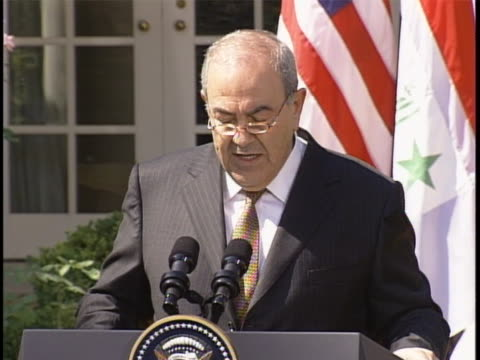 vídeos de stock, filmes e b-roll de iraq prime minister ayad allawi speaks at the white house rose garden the prime minister states and responds to the president of the united states... - (war or terrorism or election or government or illness or news event or speech or politics or politician or conflict or military or extreme weather or business or economy) and not usa