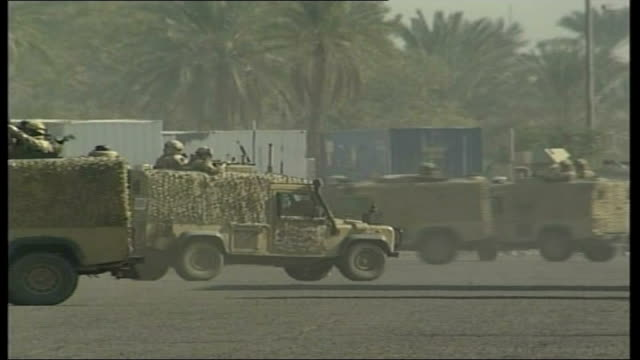 iraq study group calls for change in foreign policy british armoured vehicle along british troops training in army trucks - iraq study group stock videos & royalty-free footage