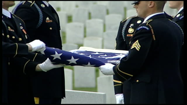 Iraq study group calls for change in foreign policy USA Virginia Arlington Arlington Cemetery EXT US military personnel ceremonially folding flag...