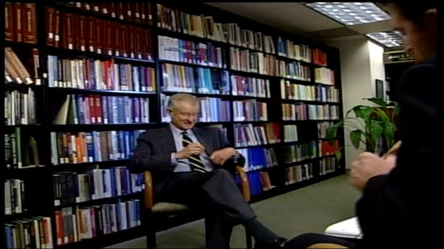 un resolution table itn zbigniew brzezinski interviewed sot if we lump them all together we will not be able to solve the problem reporter brzezinski... - {{asset.href}} stock videos & royalty-free footage