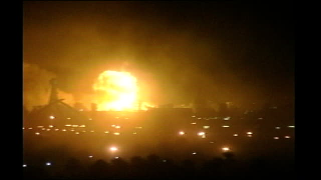 iraq war 1oth anniversary: jack straw interview; lib ext at night various of explosions in city at beginning of 'shock and awe' bombing of baghdad by... - iraq stock videos & royalty-free footage