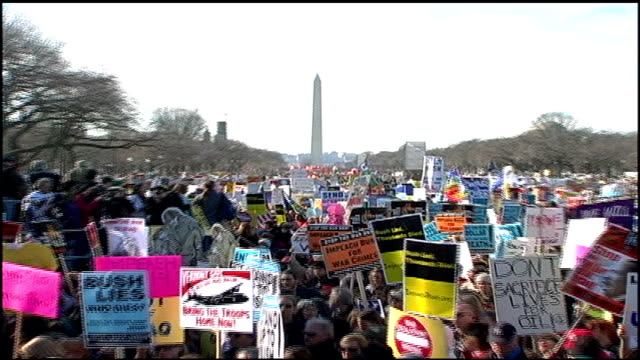 iraq war protest crowd shot of protesters and signs in washington dc - 2007 stock-videos und b-roll-filmmaterial